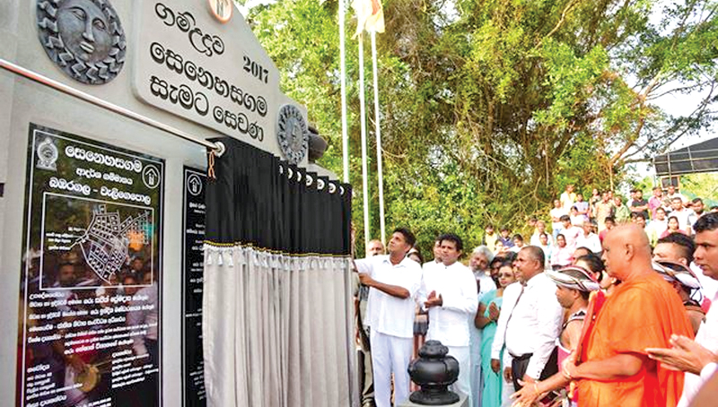 Minister Sajith Premadasa unveiling the plaque of the Senehasa gama. Picture by T.L.A.P. Hemapala, Nagoda Group Corr.