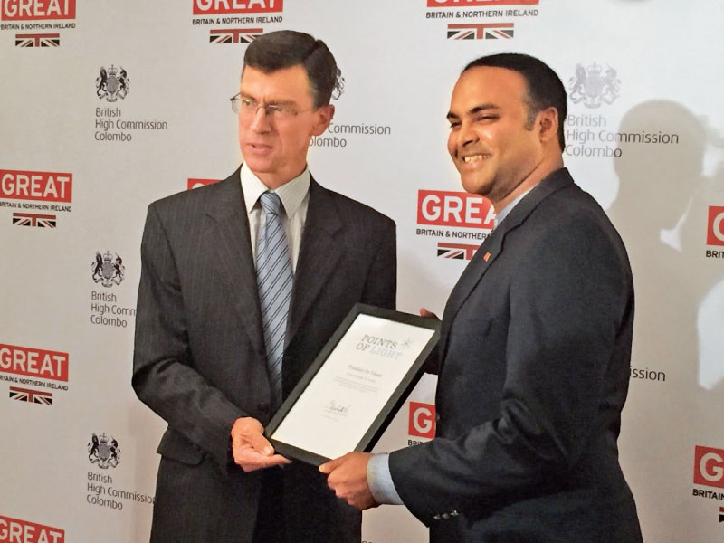 Receiving the Queens Point of Light for Sri Lanka Award from British High Commissioner to Sri Lanka and British Ambassador to Maldives James Dauris