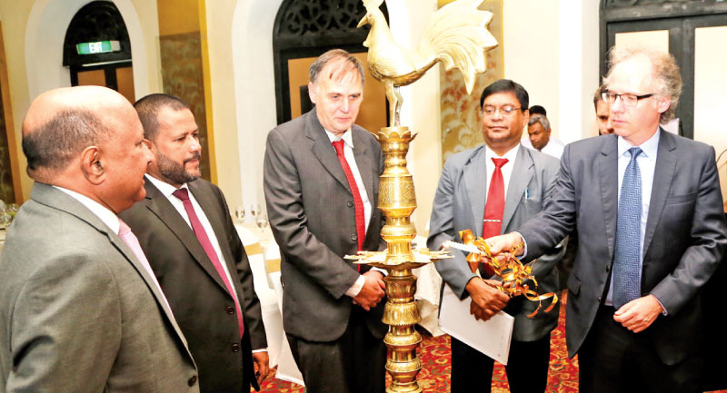 Chairman of CAA Anura Meddegoda, Minister of Industry and Commerce Rishad Bathiudeen, Head of Cooperation of the Delegation of the European Union Delegation in Sri Lanka Frank Hess, Secretary of Ministry of Telecommunication and Digital Infrastructure Chulananda Perera look on as visiting e-commerce expert from Geneva's International Trade Centre Professor Michael Geist lights the ceremonial lamp at the launch of second e-commerce PPD in Colombo yesterday.