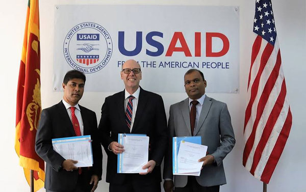 USAID Mission Director Reed Aeschliman with senior officials from Sampath Bank and Hatton National Bank.