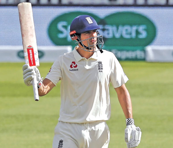 England's Alastair Cook acknowledges the applause after reaching his fifty during play on the first day of the fifth Test cricket match between England and India at The Oval in London on September 7.  AFP