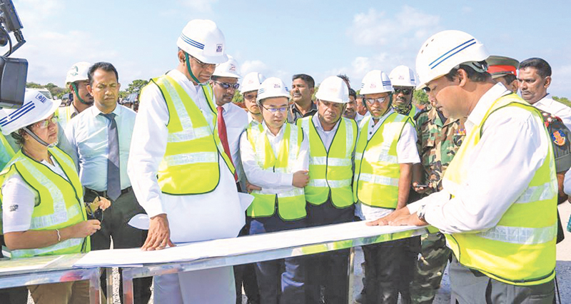 Megapolis and Western Development Minister Patali Champika Ranawaka inspects the landfill site.
