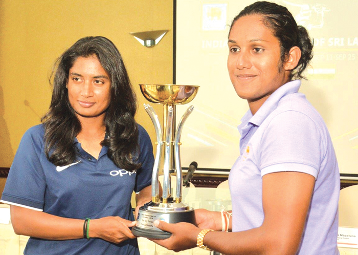 Rival captains India's Mithali Raj (left) and Sri Lanka's Chamari Atapattu pose with the trophy that will be awarded to the winners of the three-match ODI series between the two sides.