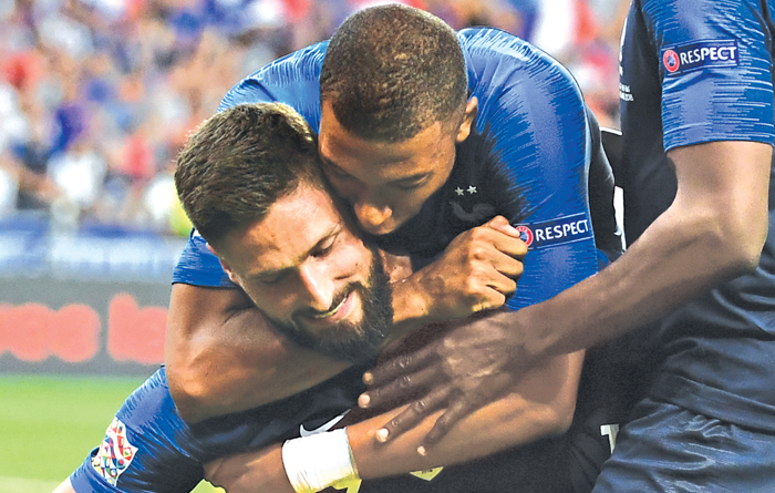 Olivier Giroud is congratulated by France's midfielder Kylian Mbappe after scoring the winner for the World Cup champions against the Dutch on Sunday. The explosive Mbappe got France's opener on a night of World Cup victory celebrations. AFP