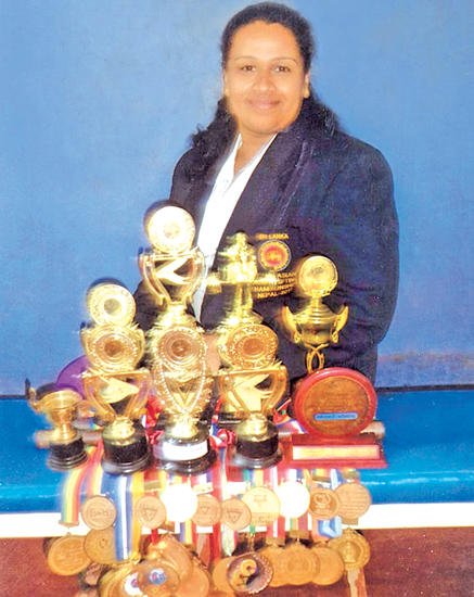 Dhammika Harischandra. with her trophies and medals  Pic. by Upananda Jayasundera-Kandy Sports Spl.Corrs.