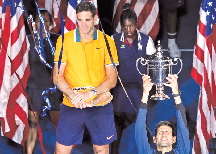 Novak Djokovic of Serbia (R) and Juan Martin del Potro of Argentina (L) pose with their trophies  after their 2018 US Open men's singles final match on September 9, 2018 in New York. AFP
