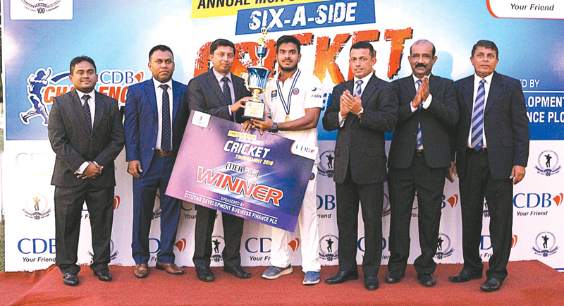 LB Finance Tier 'A' winning captain, Angelo Perera  (4th from right) receiving the CDB Trophy from  Director & Chief Credit Officer,  CDB, Sasendra  Munasinghe  (3rd from left). Others in the picture from left – Deputy General Manager, Marketing, CDB , Dharshana Jayasinghe,  Deputy General Manager,  Innovation & Business Inteligence, Hasitha Dasanayake,  President MCA, Roshan Iddamalgoda,  Gen. Secretary MCA, Nalin Wickremesinghe and Chairman Tournament  Committee  MCA, Sujeewa  de Silva.