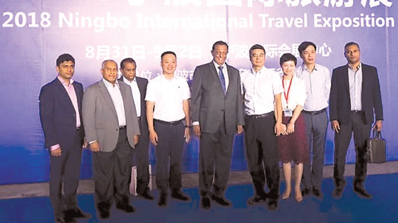 Chairman, Ningbo Municipal Tourism Administration, Li Zhemin and other officials with Minister of Tourism Development and Christian Religious Affairs, John Amaratunga