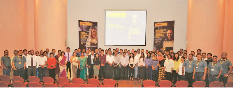 DHL, EDB officials and participants at the event