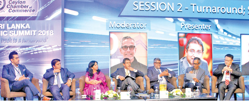 Panel discussion - From left; Shalin Balasuriya - Director and Co-Founder, Spa Ceylon - Luxury Ayurveda Spa, Jeevan Gnanam , Chairman SLASSCOM & Co-Founder Hatch, Shivani Hegde - Managing Director / CEO, Nestlé Lanka PLC, Dr. Harsha De Silva,  State Minister of National Policies and Economic Affairs, CEO Captain Ravindra Jayawickreme, CEO of Hambantota International Port Group (Pvt) Ltd, Peter D'Almeida,  Chief Executive Officer, N-Able (Pvt) Ltd, and Liang Thow Ming,  Chief Sales & Marketing Officer, CHEC