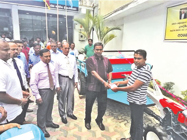 A customer receives his credit facility from the RDB officials.