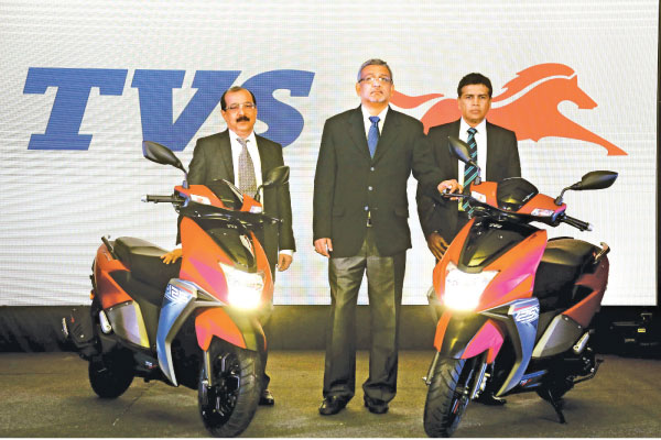Nana Rav, Director - Operations TVS Lanka,   R. Dilip, Senior Vice President  International Business at TVS Motor Company.  Ravi Liyanage, Chief Executive Officer of TVS Lanka.  Picture by Sudath Malaweera