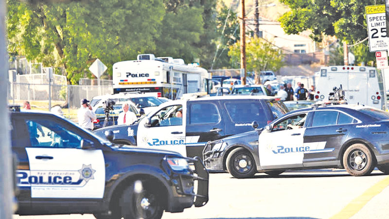 Police cars outside the shooting scene at Bakersfield, California.