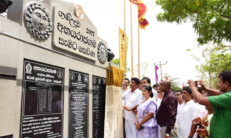 Minister Sajith Premadasa unveiling the plaque marking the opening of the model village.