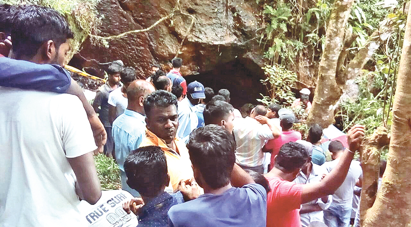 The crowd that gathered outside the cave in Ragala where the victims entered for hunting. Picture by Asela Kuruluwansa