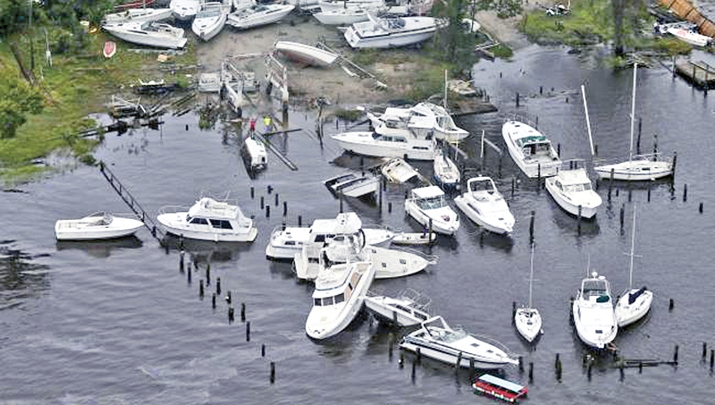 Boats are stacked up on each other in a marina as a result of the tropical Hurricane Florence