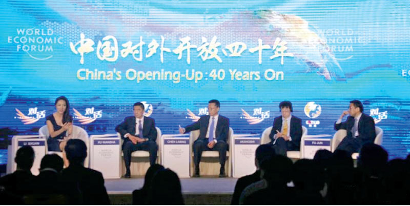 "The panel discussion themed on ""China's Opening-Up: 40 Years On"" is held during the Summer Davos on Sept 18, 2018 in Tianjin. Photo by Gao Zhan/China.org.cn"