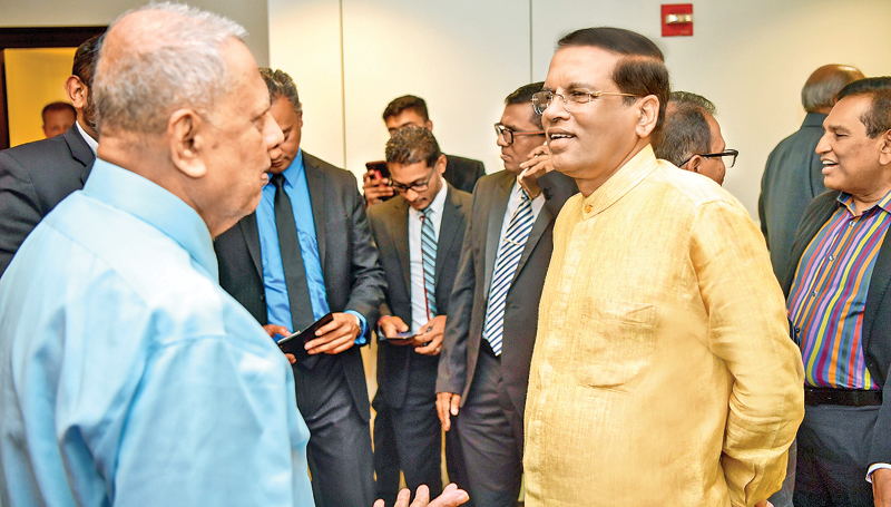 President Maithripala Sirisena met the Sri Lankan community in New York during his visit to New York to attend the 73rd Session of the United Nations General Assembly. The event was held at Sri Lanka's Permanent Mission in New York. The President having a chat with one of the Sri Lankans. Picture by Sudath Silva