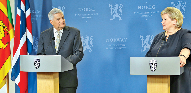 Prime Minister Ranil Wickremesinghe attends a joint press conference with Norway's Prime Minister Erna Solberg after their meeting in Oslo, Norway yesterday. Picture by Rukmal Gamage