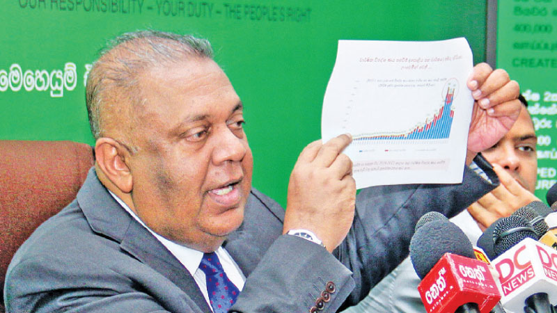 Finance and Media Minister Mangala Samaraweera speaking at yesterday's media briefing. Picture by Hirantha Gunathillake