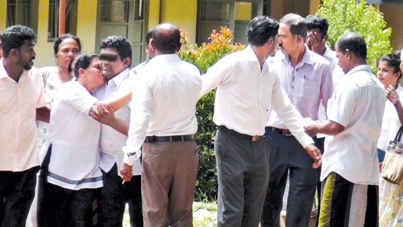 The three youths who were arrested were released yesterday by the Dambulla Magistrate with a severe warning.The youth outside court received by their relatives. Picture by Kanchana Kumara Ariyadasa