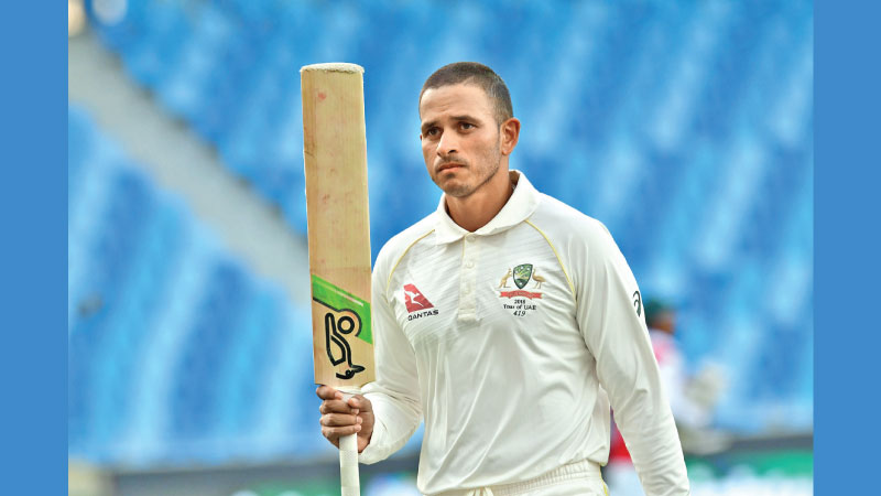 Australian cricketer Usman Khawaja leaves the pitch after being dismissed by Pakistan batsman Yasir Shah during day five of the first Test cricket match in the series between Australia and Pakistan at the Dubai International Stadium in Dubai on October 11. AFP