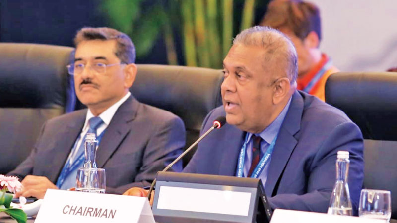 Finance and Mass Media Minister Mangala Samaraweera addressing the Intergovernmental Group of 24 Ministers and Governors meeting as the Chairman in Bali, on the sidelines of the IMF and World Bank Annual Meetings flanked by Deputy Governor Central Bank P. Nandalal Weerasinghe.