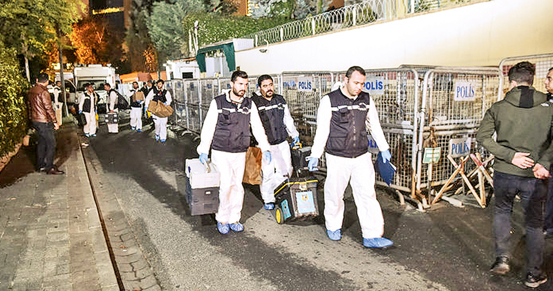 Turkish forensic police officers leave after gathering evidence at the Saudi Arabian consulate in Istanbul early on October 18.