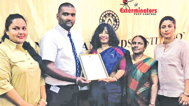Exterminators receives the ISO 22000 (FSMS) certificate from Dr. Siddika G. Senarathne, Director General, SLSI and Samanthi Narangoda, Director System Certification SLSI. Shehani De Waas, S Murughathasan and Anjela Perera look on
