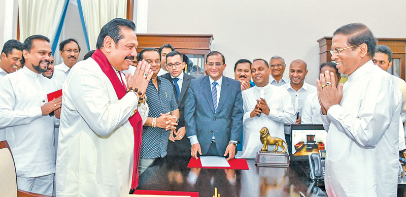 Former President Mahinda Rajapaksa was sworn in as the new Prime Minister of the Democratic Socialist Republic of Sri Lanka before President Maithripala Sirisena at the Presidential Secretariat last evening. Picture by Sudath Silva.