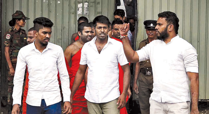 Amith Weerasinghe and the other two suspects leave the Kandy High Court on Monday. Picture by Asela Kuruluwansa