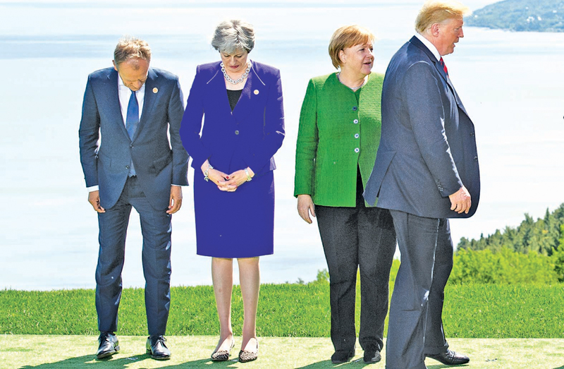 European Council President Donald Tusk (from Left), British Prime Minister Theresa May, German Chancellor Angela Merkel, and U.S. President Donald Trump prepare for a photo at the G-7 summit in La Malbaie, Canada, on June 7.