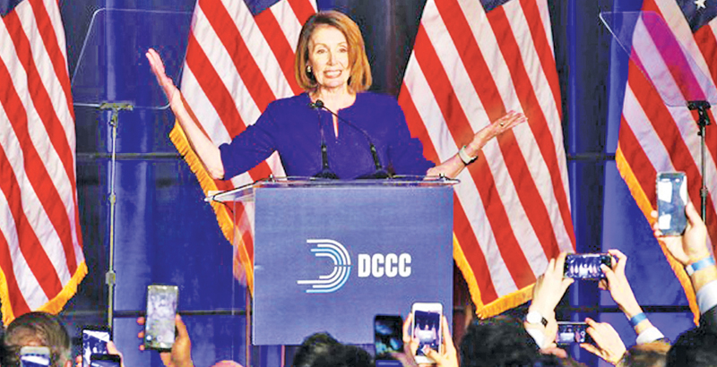 House Minority Leader Nancy Pelosi of California smiles as she is cheered by a crowd of Democratic supporters during an election night returns event at the Hyatt Regency Hotel, on Tuesday.