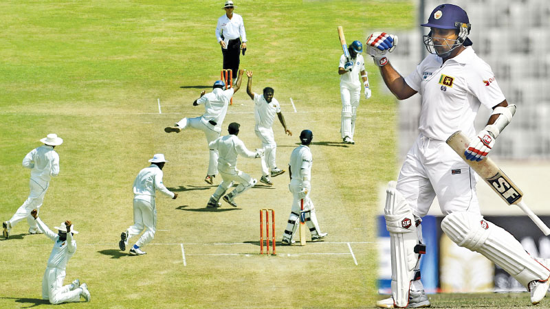 Mahela Jayawardene diving and grabbing the  catch  and holding the ball aloft waving it to the spectators signalling Muralitheran's record setting 800th Test wicket with team mates rushing to congratulate Muralitheran after capturing that wicket. At the Galle International Cricket Stadium (on right).