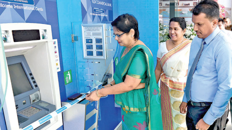 Commercial Bank's Deputy General Manager Personal Banking Sandra Walgama open the Bank's 800th ATM in Sri Lanka at the relocated Giriulla branch.