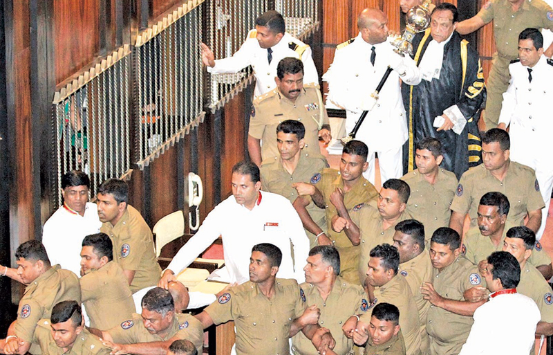 Speaker Karu Jayasuriya entering the Chamber with a posse of policemen from the MPs' entrance for the session. Picture by Dushmantha Mayadunne