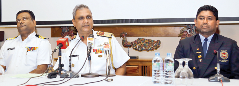 President of National Rifle Association Rear Admiral Neraj Attygalle speaking at a press briefing held recently. Secretary of National Rifle Association Captain Manjula Dissanayake (left) and IPSC Sri Lanka Regional Director Lieutenant Colonel (Retired) Janaka Ritigahapola (right) are also in the picture. Picture by Samantha Weerasiri