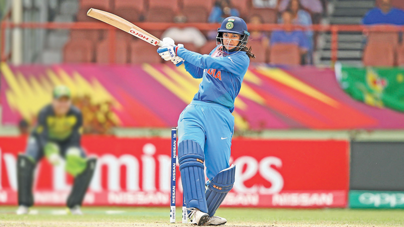 India Women's Smriti Mandhana who was named Player of the Match pulls for runs during her career best knock of 83 against Australia Women