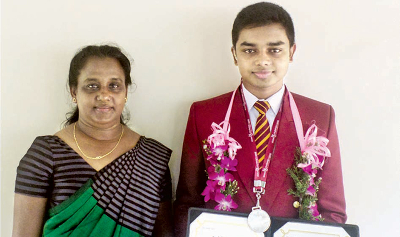 Pramuditha with his mother