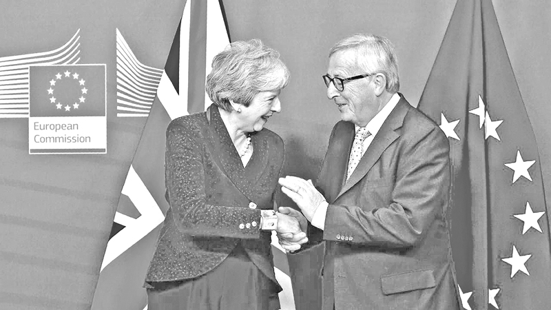 EU Commission President Jean-Claude Juncker shakes hands with Britain's Prime Minister Theresa May when they held Brexit talks earlier this week.