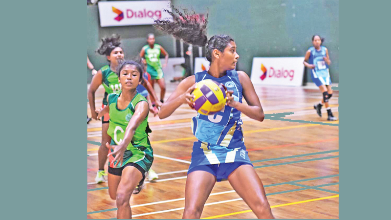HNB's Gayanjali Amarawansa (with ball)  attempts a pass in their match against Army SC.