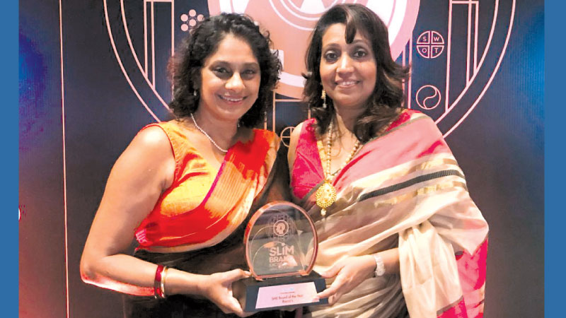 Krishanthi and Judy with the award