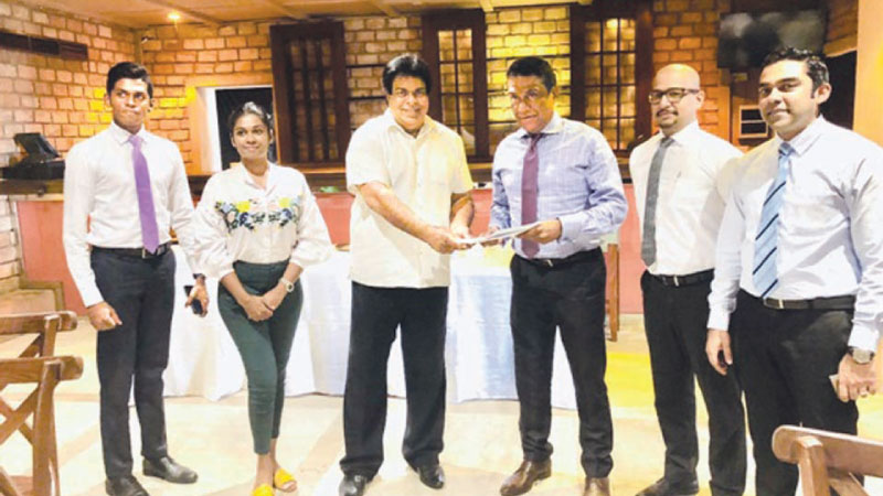 Elite Promotions & Events Chairman, Richard De Zoysa and Mount Lavinia Hotel Group General Manager Bazeer Cassim exchanging the agreement.