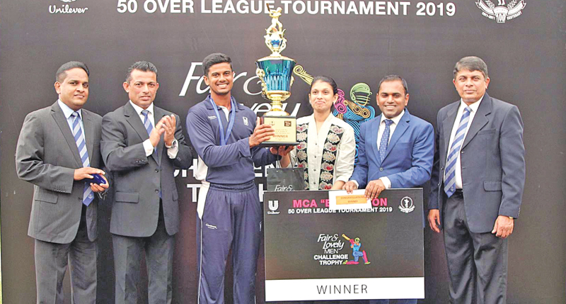 The winning captain, John Keells 'B', Ashan Peiris (3rd from left) receiving the Fair & Lovely Men Trophy from the chief guest, Marketing Director, Personal Care Unilever, Nilushi Jayatillake (03rd from right).Others in the picture from left: Mahesh de Alwis, General Secretary - MCA, Roshan Iddamalgoda President - MCA, Daminda Perera - Senior Brand Manager - Face Care - Unilever - guest of honor and  Sujeewa de Silva - Chairman T/C - MCA.