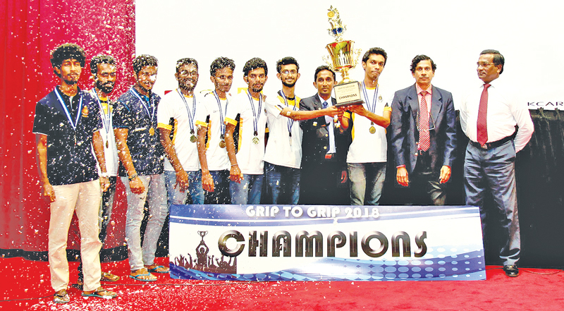 The men's champion Moratuwa University team with the trophy and guests