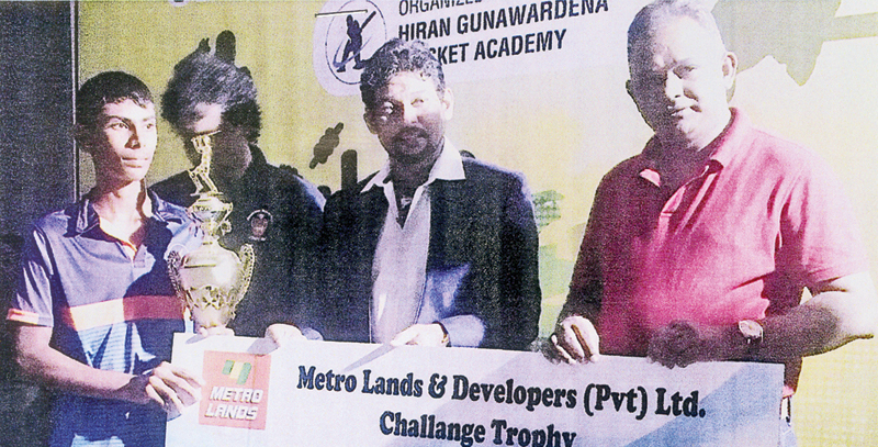 The Managing Director of Metro Lands and Developers (Pvt) Ltd Deepal Herath handing over the challenge trophy and a cheque for Rupees 20,000 to the captain of H. G. Academy Omesh Udara. Also in the picture is the General Secretary of the Sri Lanka Schools Cricket Association Dilshan de Silva. (Picture by Dilwin Mendis, Moratuwa Sports Special Correspondent)