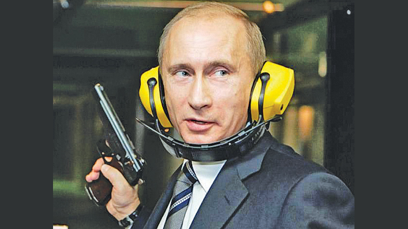 Russian President Vladimir Putin stands at a shooting gallery of the GRU military intelligence headquarters.