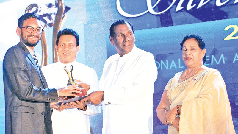Redha Refai, Director, Zam Gems receives the gold award for the best Gem & Jewellery Merchant & Silver award for best exporter (Jewellery) from Minister John Senewirathne while Minister Summedha G. Jayasena and Chairman National Gem Jewellery Authority, Peshala Jayarathne look on. Picture by Sumanachandra Ariyawansa