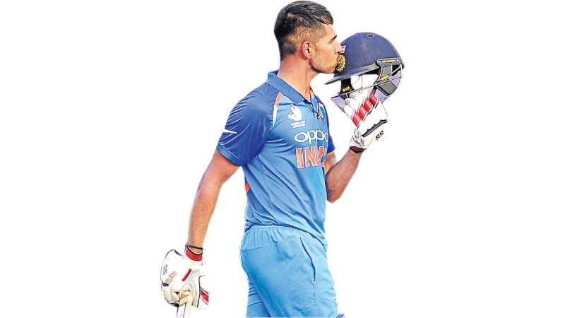 India's Himmat Singh who scored an unbeaten 126 not out celebrates his century.