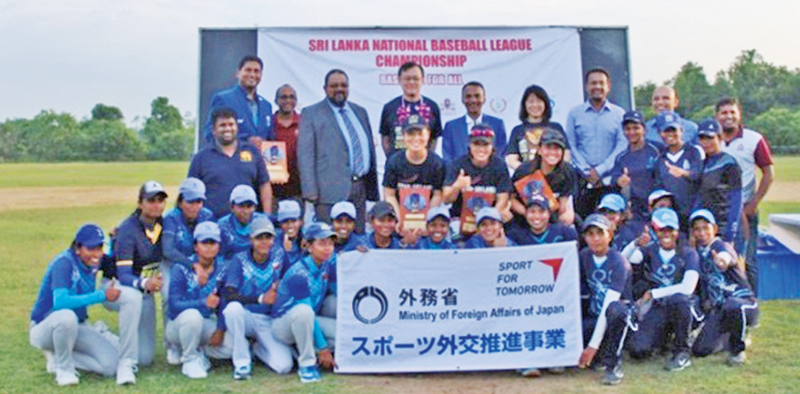 Participants with Japanese embassy officials and coaches.